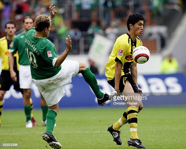 Nuri Sahin of Dortmund fights for the ball against Andres DAlessandro of Wolfsburg during the Bundesliga match between VFL Wolfsburg and Borussia...