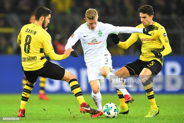 Nuri Sahin of Dortmund Florian Kainz of Bremen and Christian Pulisic of Dortmund fight for the ball during the Bundesliga match between Borussia...