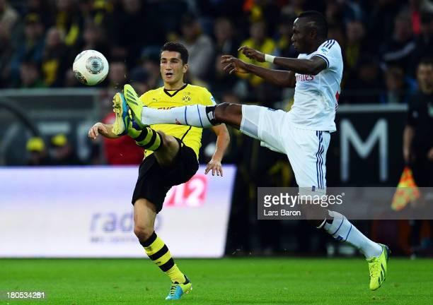 Nuri Sahin of Dortmund is challenged by Zoua Daogari of Hamburg during the Bundesliga match between Borussia Dortmund and Hamburger SV at Signal...