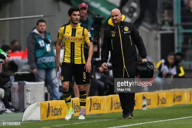 Nuri Sahin of Dortmund leaves the pitch after injury during the Bundesliga match between Borussia Moenchengladbach and Borussia Dortmund at...