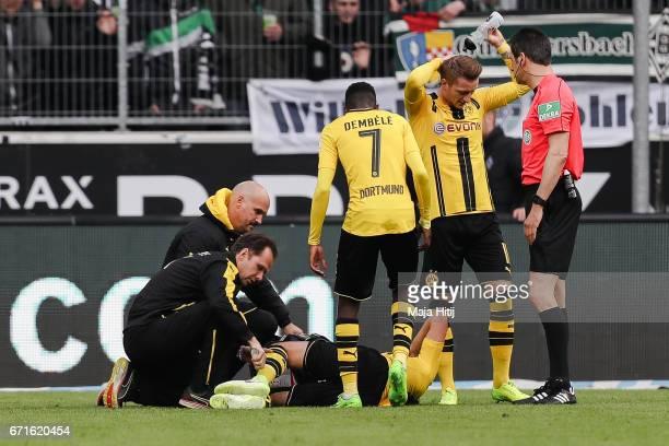 Nuri Sahin of Dortmund lies injured during the Bundesliga match between Borussia Moenchengladbach and Borussia Dortmund at BorussiaPark on April 22...