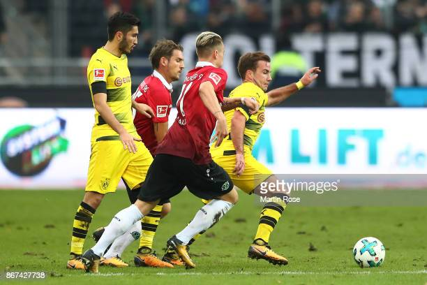 Nuri Sahin of Dortmund Oliver Sorg of Hannover Felix Klaus of Hannover and Mario Goetze of Dortmund fight for the ball during the Bundesliga match...
