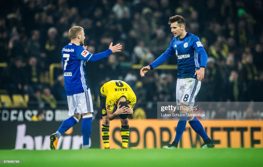 Nuri Sahin of Dortmund (C) reacts after the Bundesliga match between Borussia Dortmund and FC Schalke 04 at Signal Iduna Park on November 25, 2017 in Dortmund, Germany.