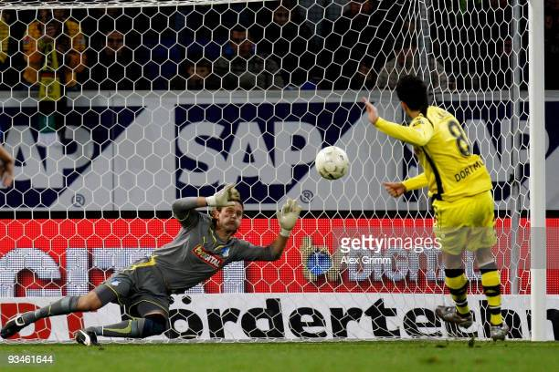 Nuri Sahin of Dortmund scores his team's second goal with a penalty against goalkeeper Timo Hildebrand of Hoffenheim during the Bundesliga match...