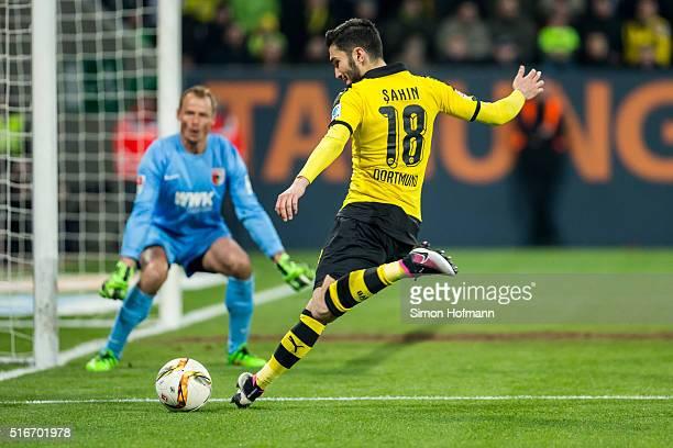 Nuri Sahin of Dortmund tries to score against goalkeeper Alexander Manninger of Augsburg during the Bundesliga match between FC Augsburg and Borussia...