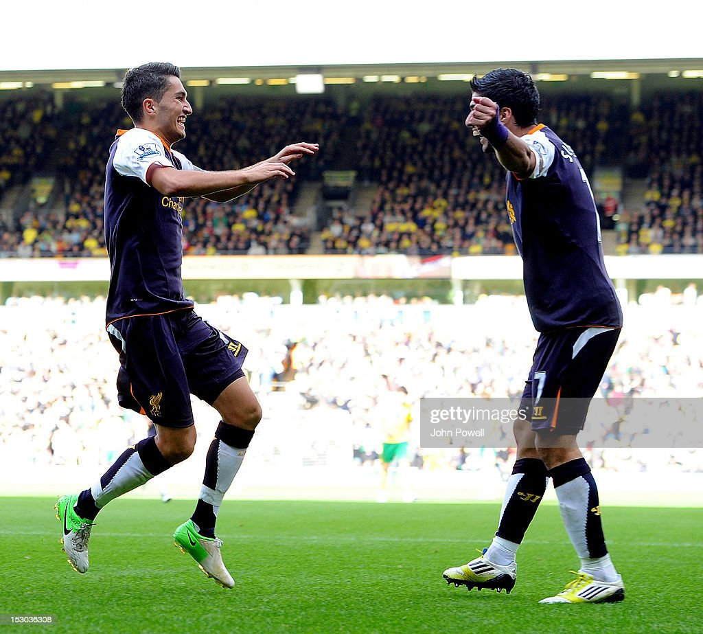 Nuri Sahin of Liverpool celebrates with team-mate Luis Suarez after scoring during the Barclays Premier League match between Norwich City and Liverpool at Carrow Road on September 29, 2012 in Norwich, England.