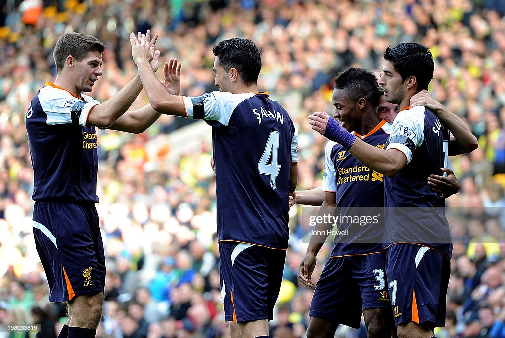 <a gi-track='captionPersonalityLinkClicked' href=/galleries/search?phrase=Nuri+Sahin&family=editorial&specificpeople=609186 ng-click='$event.stopPropagation()'>Nuri Sahin</a> of Liverpool celebrates with team-mates <a gi-track='captionPersonalityLinkClicked' href=/galleries/search?phrase=Steven+Gerrard&family=editorial&specificpeople=202052 ng-click='$event.stopPropagation()'>Steven Gerrard</a>, <a gi-track='captionPersonalityLinkClicked' href=/galleries/search?phrase=Raheem+Sterling&family=editorial&specificpeople=6489439 ng-click='$event.stopPropagation()'>Raheem Sterling</a> and Luis Suarez after scoring during the Barclays Premier League match between Norwich City and Liverpool at Carrow Road on September 29, 2012 in Norwich, England.
