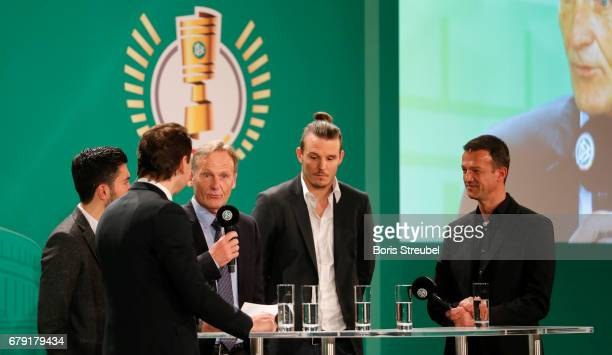 Nuri Sahin player of Borussia Dortmund Ralf Koettker DFB media director Hans Joachim Watzke CEO of Borussia Dortmund Alexander Meier of Eintracht...