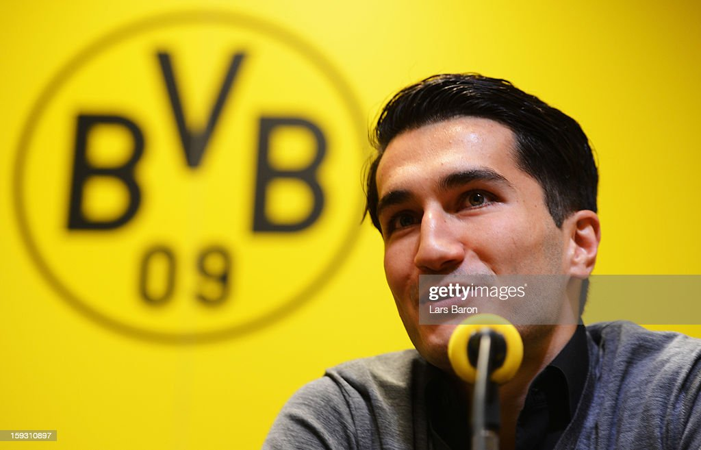 <a gi-track='captionPersonalityLinkClicked' href=/galleries/search?phrase=Nuri+Sahin&family=editorial&specificpeople=609186 ng-click='$event.stopPropagation()'>Nuri Sahin</a> smiles during a Borussia Dortmund press conference at Signal Iduna Park on January 11, 2013 in Dortmund, Germany.