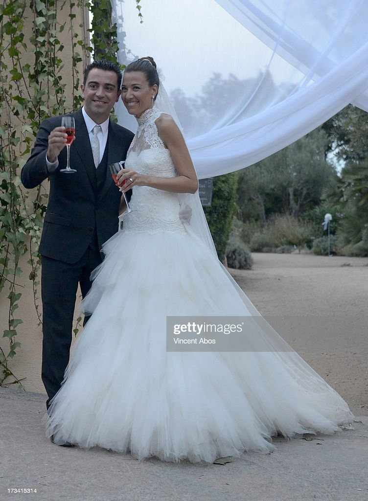 Nuria Canillera and <a gi-track='captionPersonalityLinkClicked' href=/galleries/search?phrase=Xavi+Hernandez+-+Soccer+Player&family=editorial&specificpeople=2834438 ng-click='$event.stopPropagation()'>Xavi Hernandez</a> pose for the press after their wedding at the Marimurtra Botanical Gardens on July 13, 2013 in Barcelona, Spain.