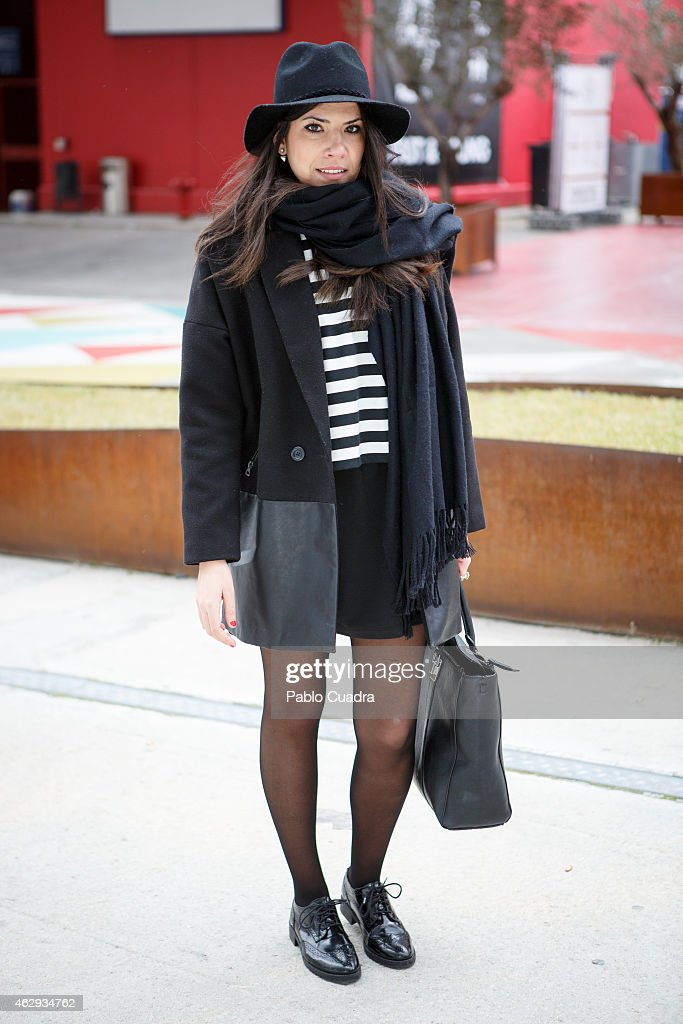 Nuria wears Zara dress and tshirt Parfois handbag Forever 21 hat and PullBear shoes during Mercedes Benz Madrid Fashion Week Fall/Winter 2015/16 at...