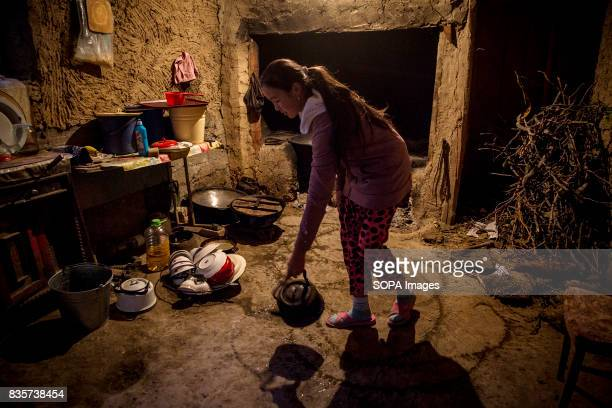 Nurjamal Alimbekov in the kitchen of her family house in the village of Lyaily near Beshkent Kyrgyzstan where nearly all 300 families use water from...