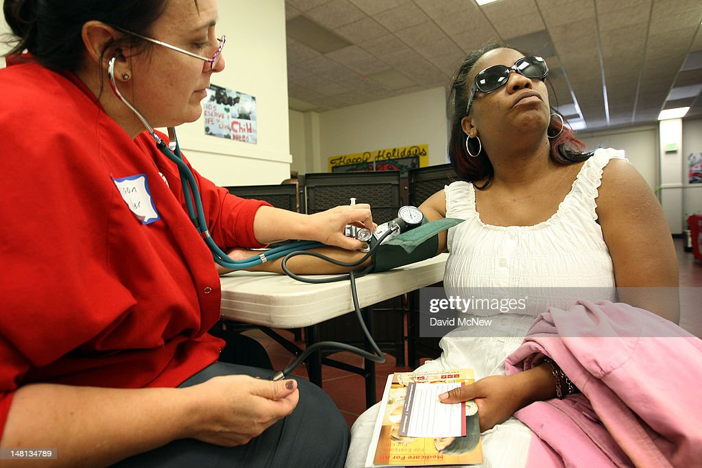 Nurse Allison Miller checks the blood pressure of Keri Anderson as nurses and physicians give free basic health screenings and call attention to what...