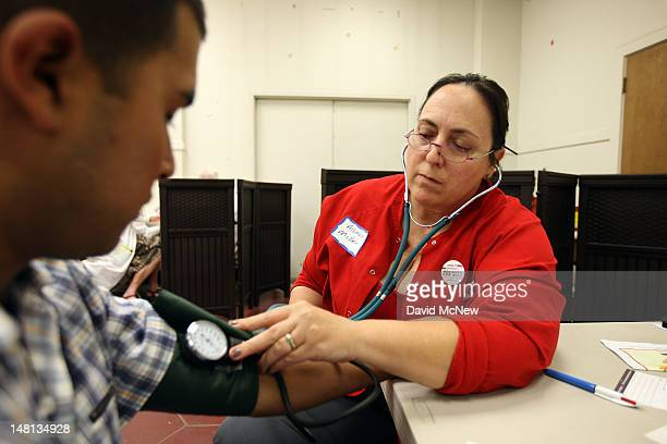 Nurse Allison Miller checks the blood pressure of Oscar Ramirez as nurses and physicians give free basic health screenings and call attention to what...