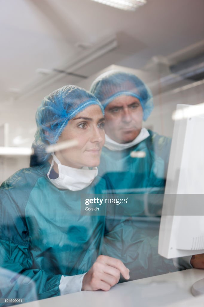 nurse and doctor looking at computer : Stock Photo