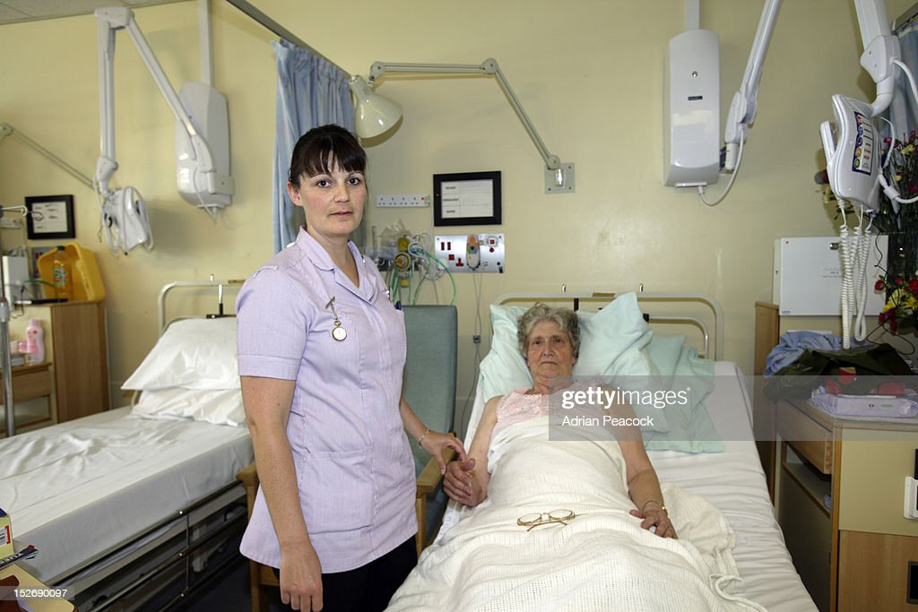 Nurse and elderly patient : Stock Photo