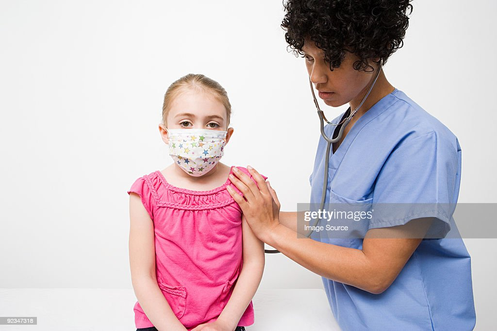 Nurse and girl in protective mask