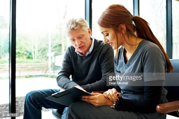 Nurse and patient examining application form