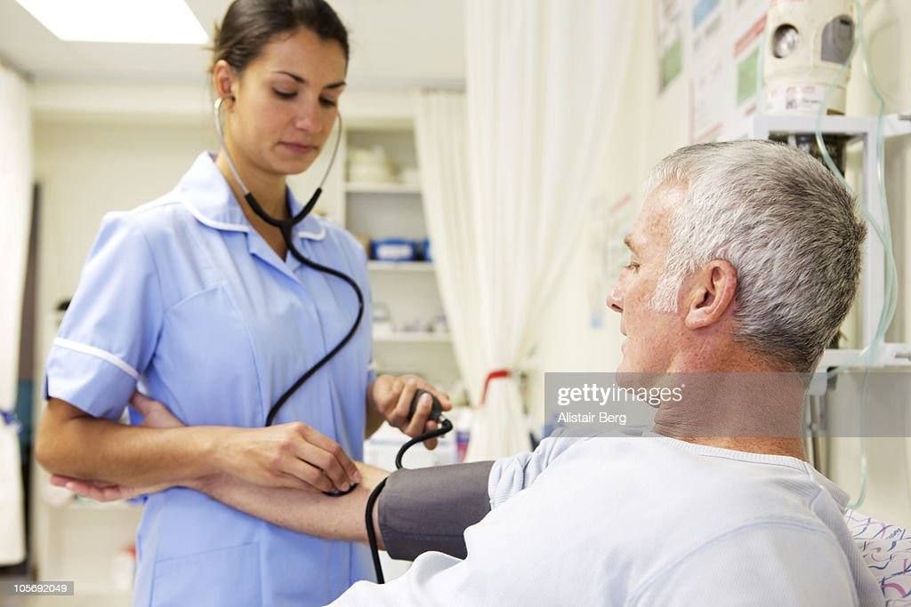 Nurse and patient in a medical clinic : Stock Photo