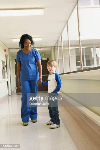 Nurse and patient in hospital corridor : Stock-Foto