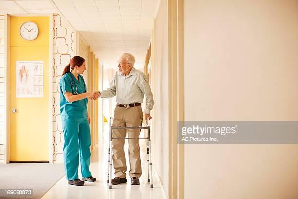Nurse and patient shake hands