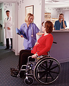 Nurse and Pregnant Lady in Wheelchair