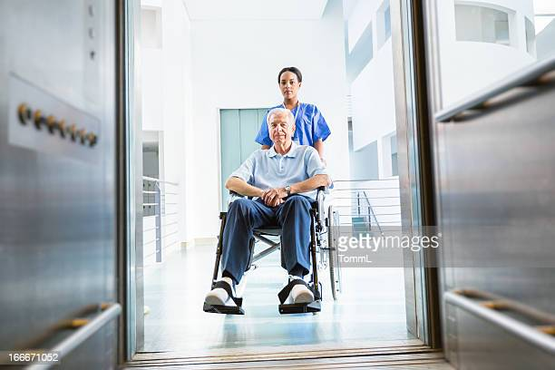 Nurse and Senior Man in Wheelchair