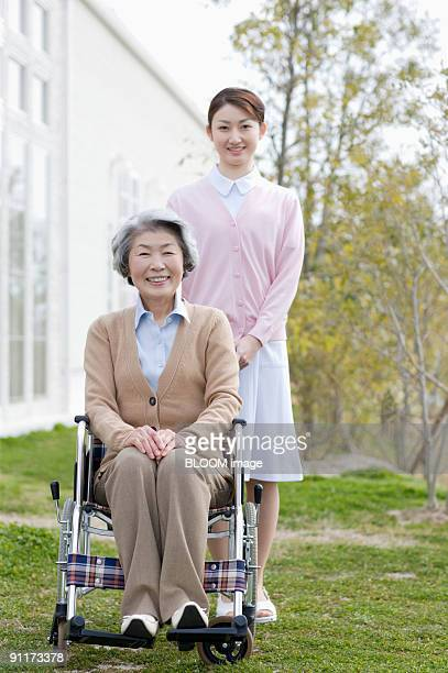 Nurse and woman in wheelchair, portrait