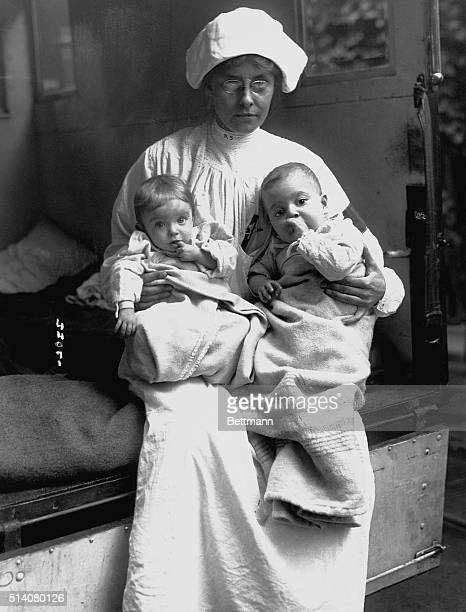 A nurse at Lincoln hospital with two infants during the infantile paralysis epidemic of 1916