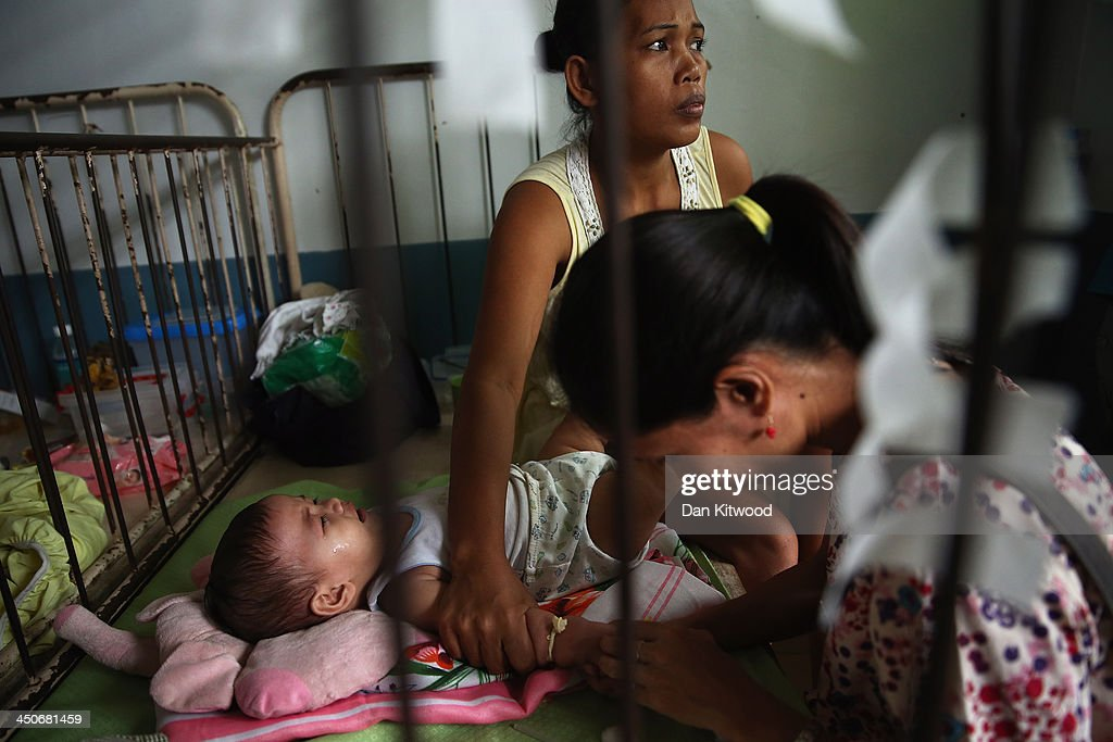 A nurse attends a crying baby in the children's and maternity ward at the Eastern Visayas Medical Centre on November 20, 2013 in Leyte, Philippines. Typhoon Haiyan which ripped through the Philippines over a week ago has been described as one of the most powerful typhoons ever to hit land, leaving thousands dead and hundreds of thousands homeless. Countries all over the world have pledged relief aid to help support those affected by the typhoon, however damage to the airport and roads have made moving the aid into the most affected areas very difficult. With dead bodies left out in the open air and very limited food, water and shelter, health concerns are growing.