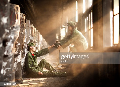 Nurse bringing water to helpless rebellion : Stock Photo