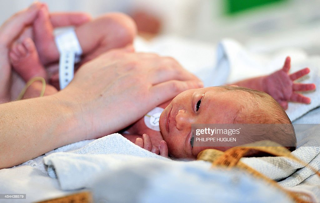A nurse cares for a premature baby in the neonatal ward of the Centre Hospitalier de Lens in Lens northern France on December 4 2013 AFP PHOTO /...