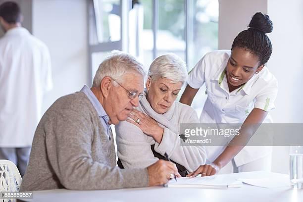 Nurse caring for senior couple