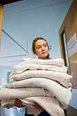 Nurse carrying pile of clean towels