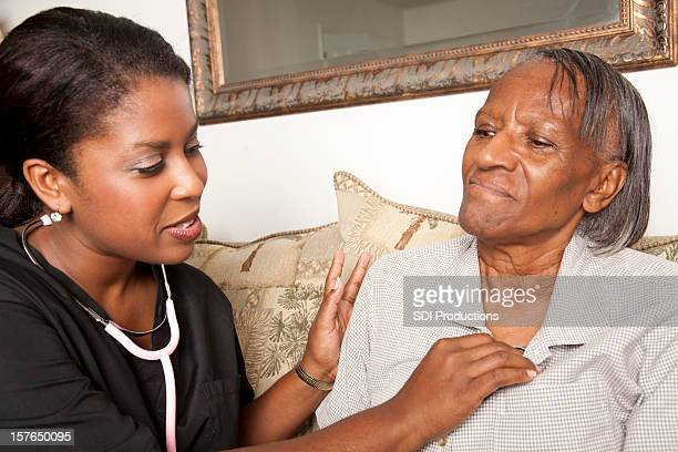 Nurse Checking Heart Rate of Her Elderly Patient