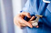 Nurse checking the time