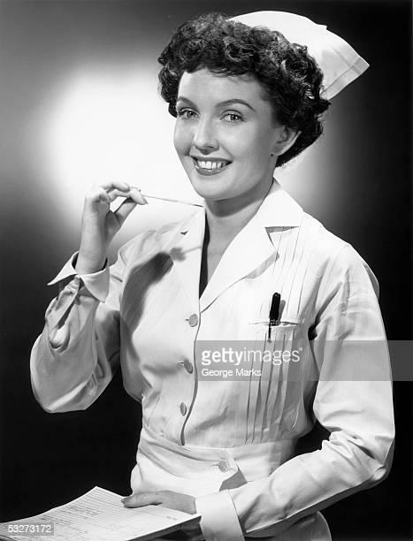 Nurse checking thermometer