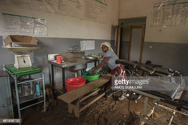 A nurse clears medical equipement from a damaged health center at Makhanga on January 20 2015 in Malawi's most southern district of Nsanje A total of...
