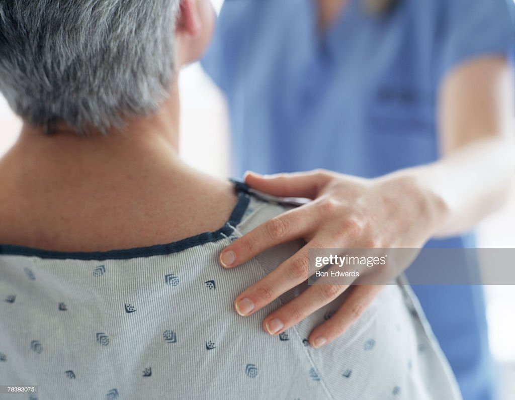 Nurse consoling a patient : Stock Photo