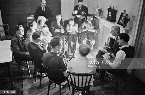Nurse Conway provides tea before bedtime at the London Husbands' Hostel at 233 Charlton Road southeast London 1940 The hostel takes in men whose...