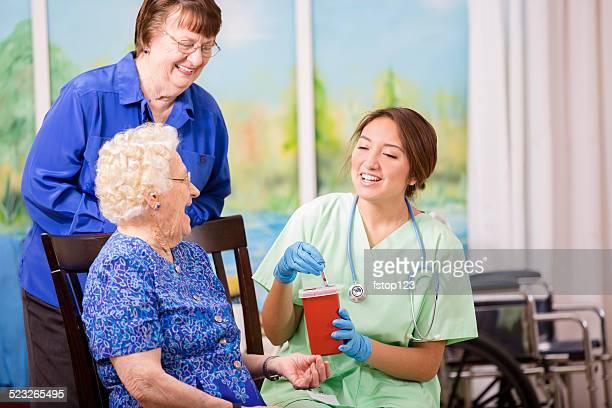 Nurse demonstrating proper disposal of medications, syringes.