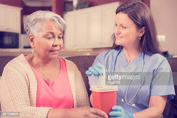 Nurse demonstrating proper disposal of syringes.