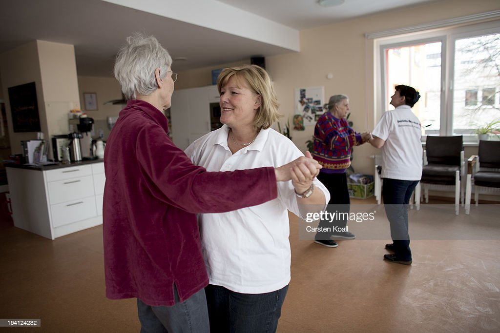 Nurse Doret Kohl (2ndL) and Caregiver Jolanta Spychalska (2ndR) dance together with day guests Hannelore (2ndR) and Monika (L) during the so called Dance Cafe in the geriatric day care facility of the German Red Cross (DRK, or Deutsches Rotes Kreuz) at Villa Albrecht on March 11, 2013 in Berlin, Germany. A great number of senior Citzens struggle with various forms of dementia at Villa Albrecht. The German Red Cross dates its origin back to 1863 with the founding of the Wuerttembergischer Sanitaetsverein, a medical association that provided care to wounded soldiers. Today the German Red Cross has four million members nationwide and is active in international aid and social care.