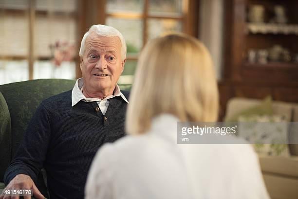 Nurse during home visit with senior man