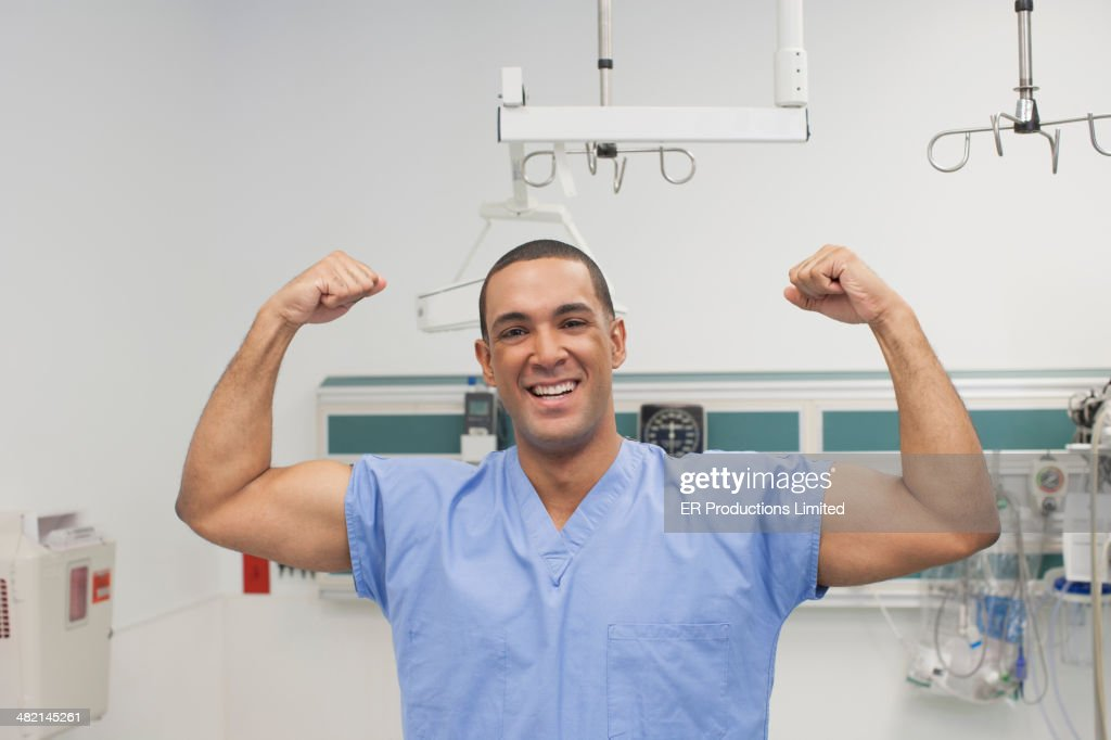 Nurse flexing his muscles in hospital