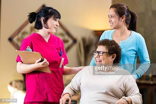 Nurse gives senior woman instructions as she leaves hospital