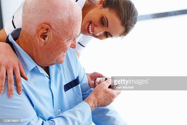 Nurse Giving Medicine to an Elderly Patient