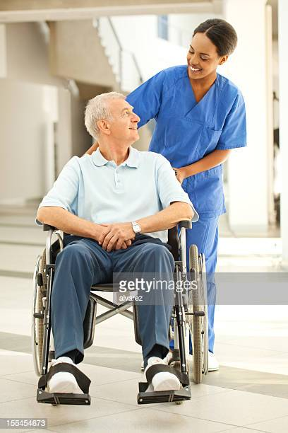 Nurse helping a patient in wheelchair