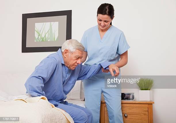 Nurse helping a senior patient