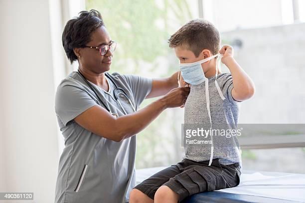 Nurse Helping Boy Put on Breathing Mask